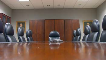 A boardroom table and chairs