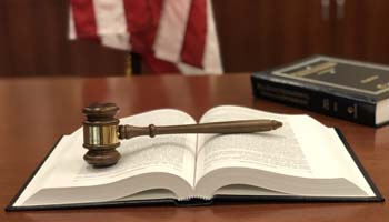 Gavel sitting on a legal textbook