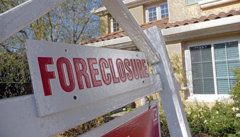 Foreclosure sign outside of a house
